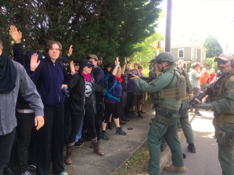 Police officers corner a group of counterprotesters at a neo-Nazi rally in Georgia on Saturday. (Christopher Mathias HuffPost)
