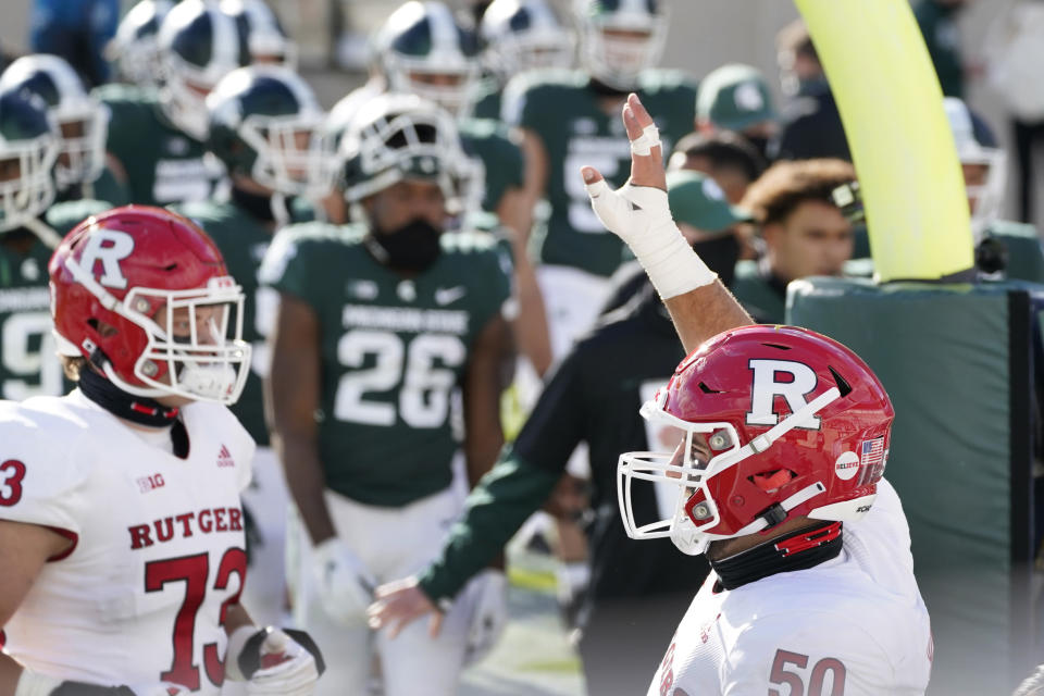 Rutgers offensive lineman Cj Hanson (50) looks towards his family after Rutgers defeated Michigan State in an NCAA college football game, Saturday, Oct. 24, 2020, in East Lansing, Mich. (AP Photo/Carlos Osorio)