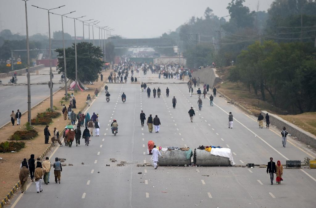 Roughly 2,000 protesters from the Tehreek-i-Labaik Ya Rasool Allah Pakistan group have blocked a main highway used by thousands of commuters since November 6 (AFP Photo/AAMIR QURESHI)