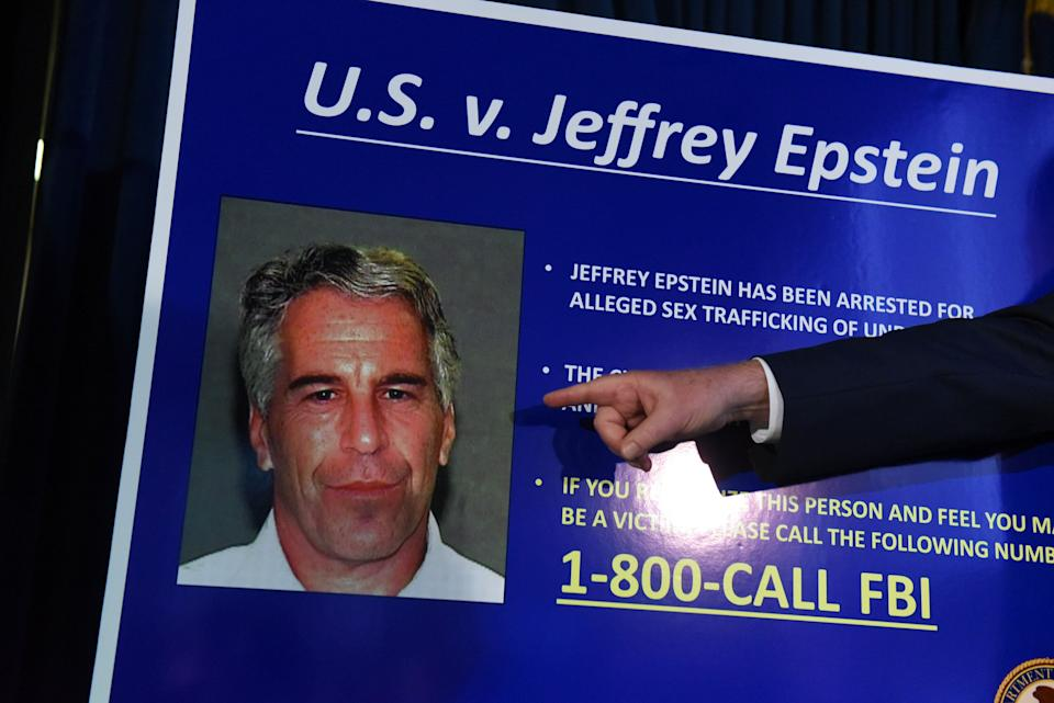 A prosecutor points to a photograph of Jeffrey Epstein at a July 2019 news conference in New York City. (Photo: Stephanie Keith via Getty Images)