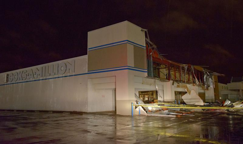 The Books-A-Million store is seen damaged by heavy wind and rain during a major storm in Monroe, La., Saturday, Dec. 21, 2013. (AP Photo/Matthew Hinton)