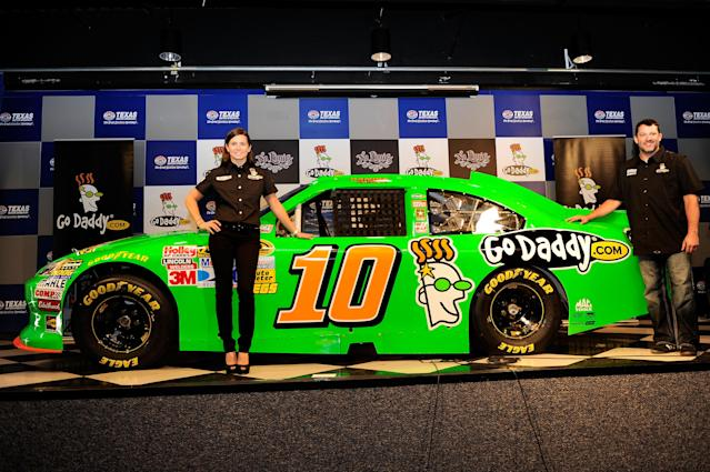 FORT WORTH, TX - NOVEMBER 04: Danica Patrick unveils her #10 GoDaddy.com Chevrolet for the 2012 season with team owner Tony Stewart following practice for the NASCAR Sprint Cup Series AAA Texas 500 at Texas Motor Speedway on November 4, 2011 in Fort Worth, Texas. (Photo by John Harrelson/Getty Images for NASCAR)