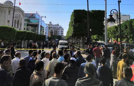 People gather near the site of an explosion in the center of the Tunisian capital Tunis, Tunisia October 29, 2018. REUTERS/Tarek Amara