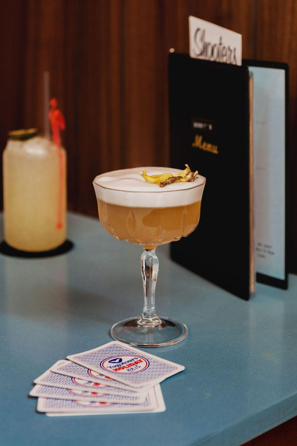<p>This cocktail bar is extremely committed to its 1970s theme. The venue is decked out just like a living room from five decades ago: Think velvet chairs (and curtains), bold, patterned wallpaper and even retro television sets placed in the corner. </p><p>The cocktail menu is split into two sections, 'Bobby's Favourites' and 'Family Affair' where each drink is named after a certain 'relative'. The venue is also known for its stone-baked, Italian pizzas and now offers bottomless brunch.</p><p>Find Bobby Fitzpatrick at 273 West End Ln.</p>
