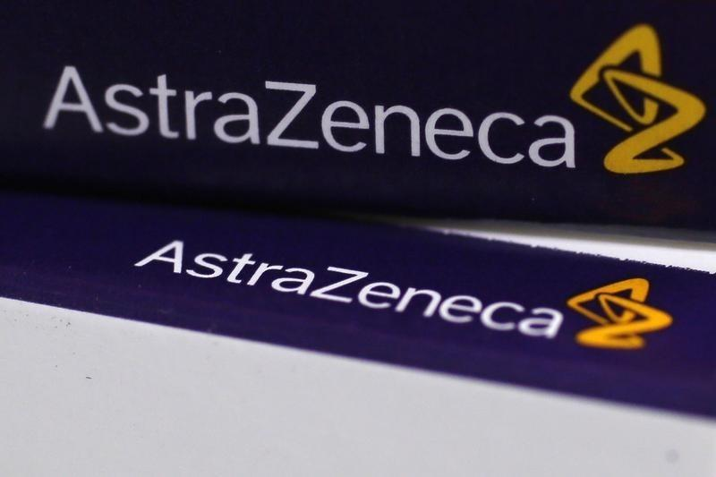 The logo of AstraZeneca is seen on medication packages in a pharmacy in London