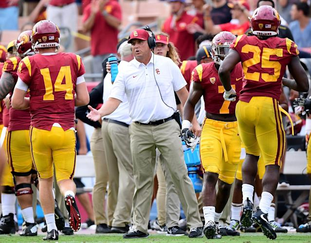 Clay Helton and the Trojans have won their last 10 games, dating back to last October. (Getty)