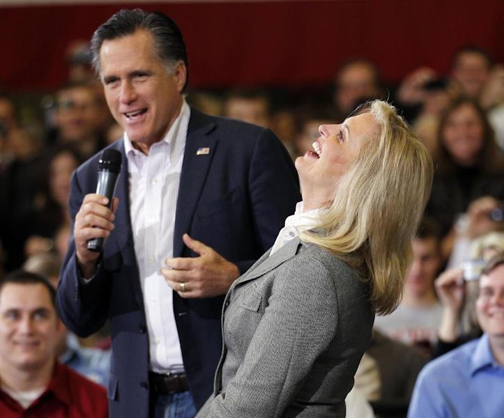 Ann Romney, wife of Republican presidential candidate, former Massachusetts Gov. Mitt Romney, laughs with him as he speaks at a town hall meeting at Taylor Winfield in Youngstown, Ohio, Monday, March 5, 2012. (AP Photo/Gerald Herbert)