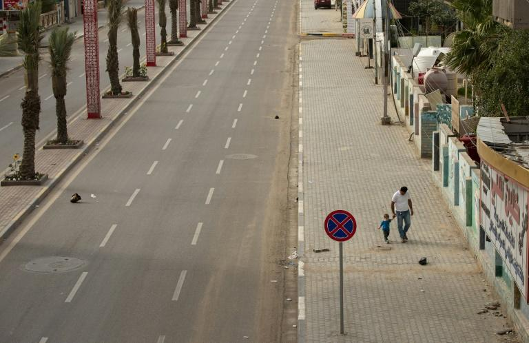 The curfew in Iraq which emptied this main road in Basra has been extended until at least April 11