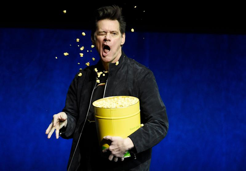 "Jim Carrey, a cast member in the upcoming film ""Sonic the Hedgehog,"" throws popcorn into his face during the Paramount Pictures presentation at CinemaCon 2019, the official convention of the National Association of Theatre Owners (NATO) at Caesars Palace, Thursday, April 4, 2019, in Las Vegas. (Photo by Chris Pizzello/Invision/AP)"