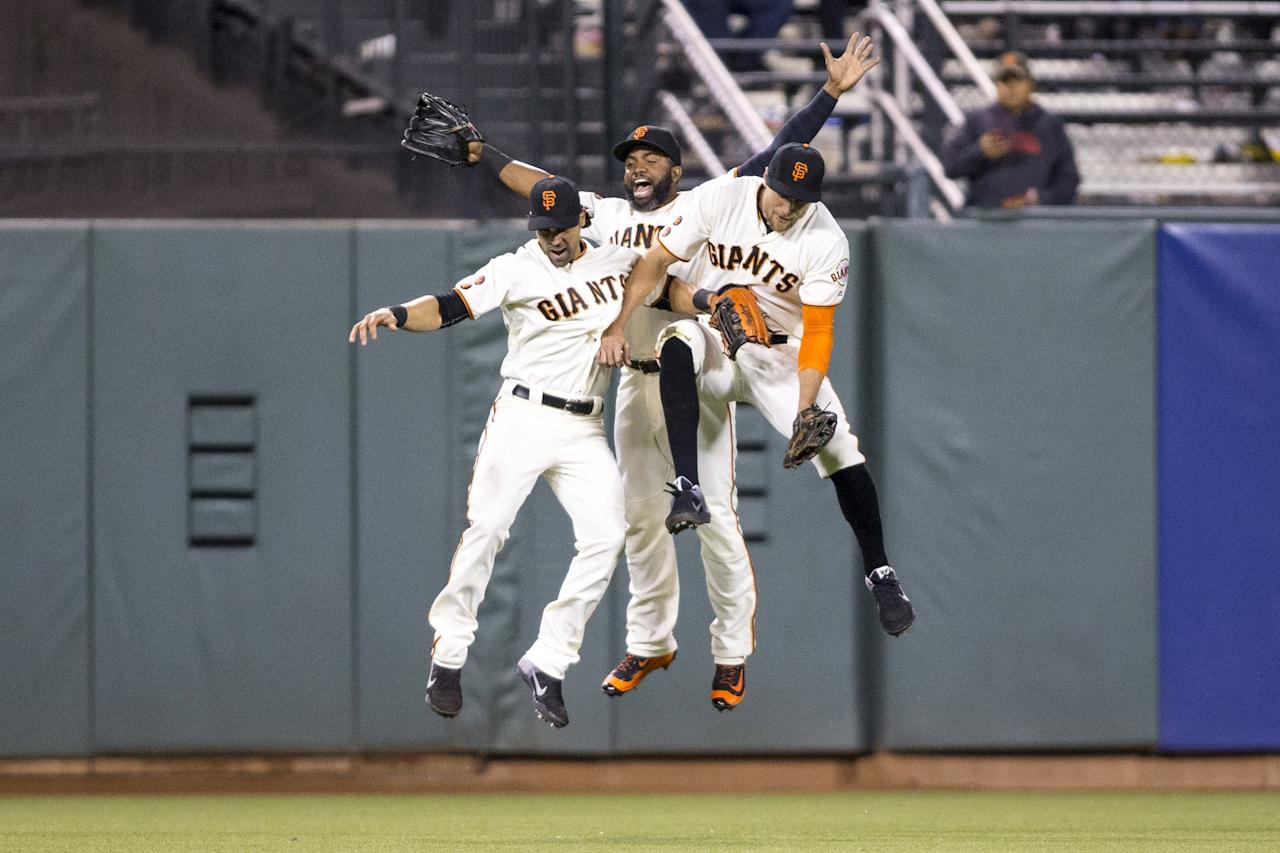 Apr 26, 2016; San Francisco, CA, USA; San Francisco Giants center fielder Denard Span (2), right fielder Hunter Pence (8) and left fielder Angel Pagan (16) celebrate after the end of the game against the San Diego Padres at AT&T Park. San Francisco Giants defeat the San Diego Padres 1 to 0. Mandatory Credit: Neville E. Guard-USA TODAY Sports TPX IMAGES OF THE DAY