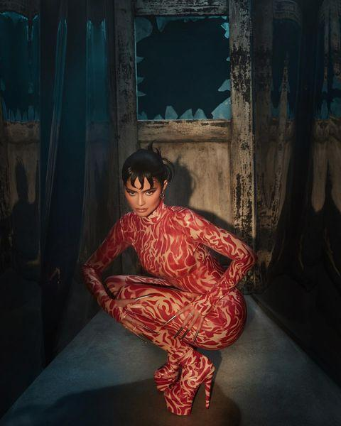 """<p>Jenner donned a Freddy Krueger Nightmare On Elm Street costume to announce her Kylie Cosmetics x Nightmare on Elm Street make-up collaboration at the beginning of October 2021. </p><p>The pregnant reality star swapped Krueger's famous red striped top and hat for a skin-tight catsuit printed with a blood red and nude-coloured pattern. She also swapped the gloves and razors for metallic black talons and her usual long black hair for a Kris Jenner-like crop. </p><p><a href=""""https://www.instagram.com/p/CUqc3iOvM2W/"""" rel=""""nofollow noopener"""" target=""""_blank"""" data-ylk=""""slk:See the original post on Instagram"""" class=""""link rapid-noclick-resp"""">See the original post on Instagram</a></p>"""