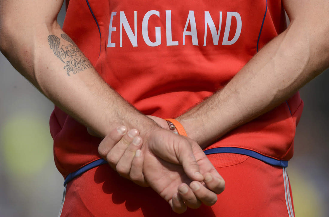 England's Kevin Pietersen waits in the field with a tattoo showing his wife and sons' names during the second one-day international against Australia at Old Trafford cricket ground in Manchester September 8, 2013. REUTERS/Philip Brown (BRITAIN - Tags: SPORT CRICKET)