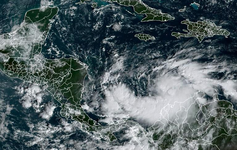 This RAMMB/NOAA satellite image shows Tropical Storm Iota on November 14, 2020; Honduras, Guatemala and Nicaragua have announced evacuations as the storm closed in on a region still reeling from deadly storm Eta