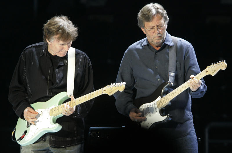FILE - In this Feb. 25, 2008 file photo, former Blind Faith bandmates Steve Winwood, left, and Eric Clapton play their Fender guitars at a concert in New York's Madison Square Garden. Fender Musical Instruments, the maker of legendary guitars favored by the likes of Buddy Holly, Jimmy Hendrix and Eric Clapton, filed papers Thursday, March 8, 2012 for a $200 million initial public offering. (AP Photo/Richard Drew, File)