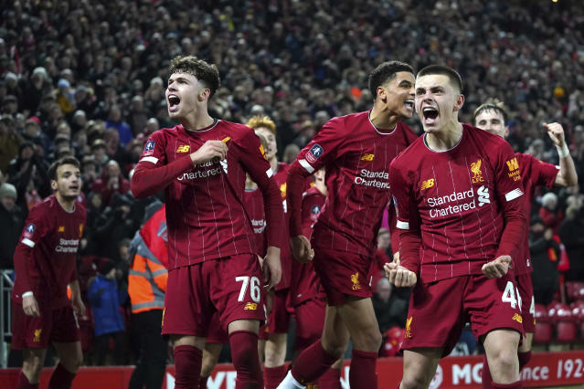 Liverpool players celebrate after Shrewsbury Town's Ro-Shaun Williams, scored an own goal during the English FA Cup Fourth Round replay soccer match between Liverpool and Shrewsbury Town at Anfield Stadium, Liverpool, England, Tuesday, Feb. 4, 2020. (AP Photo/Jon Super)