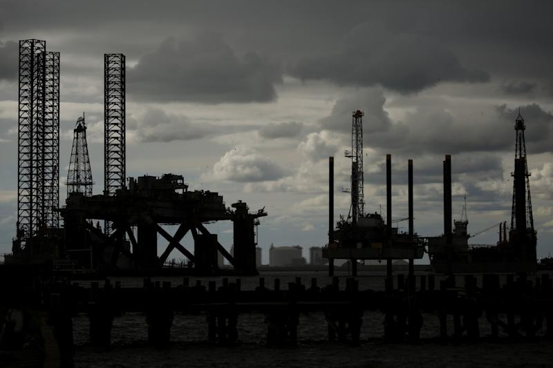 Oil rises on strong factory activity, crude drawdown forecast