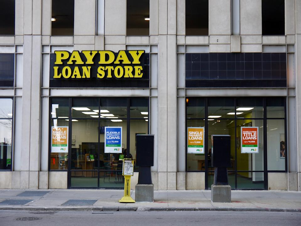 Exterior view of a payday loan store in downtown Chicago, Illinois, 2019 (Photo by Interim Archives / Getty Images)