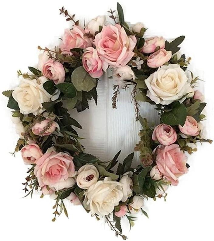 <p>Hang this stunning <span>Adeeing 13'' Handmade Peony Flower Wreath </span> ($23) on your front door.</p>