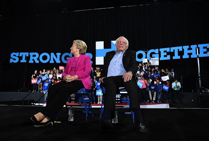 Clinton and Sanders listen to singer Pharrell Williams during a campaign rally in Raleigh, N.C., in November 2016. (Photo: Jewel Samad/AFP via Getty Images)