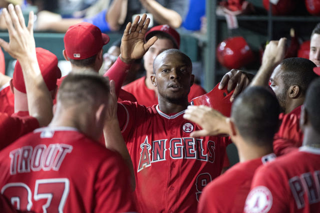 "<a class=""link rapid-noclick-resp"" href=""/mlb/players/8080/"" data-ylk=""slk:Justin Upton"">Justin Upton</a> (center) will stay with the Angels for the next five seasons after agreeing to a new contract. (AP)"