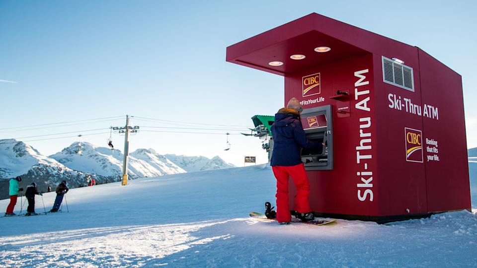 CIBC takes banking to new heights with Canada's first ski-thru ATM at the top of Whistler Mountain at Whistler Blackcomb Ski Resort.