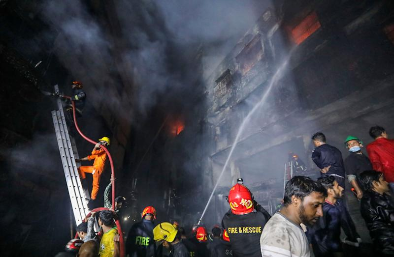 Firefighters work to douse flames in Dhaka, Bangladesh, Feb. 21, 2019. A devastating fire raced through at least five buildings in an old part of Bangladesh's capital and killed scores of people. (Photo: Zabed Hasnain Chowdhury/AP)