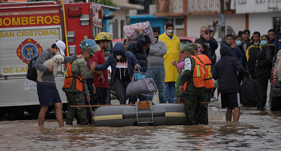 State police evacuate families from the flooded area in the municipality of San Cristobal de las Casas, in the state of Chiapas, Mexico.