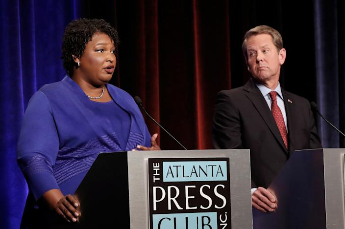 Democratic gubernatorial candidate for Georgia Stacey Abrams speaks as Republican candidate Brian Kemp looks on during a debate in Atlanta, Georgia, on October 23, 2018. (Photo: John Bazemore/Pool via Reuters)