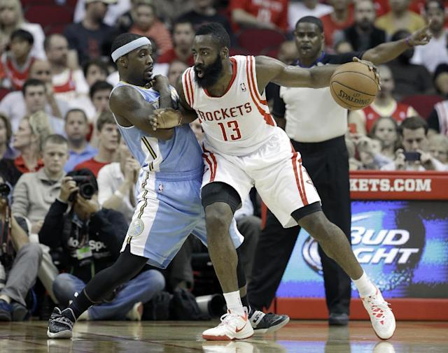 Houston Rockets' James Harden (13) pushes against Denver Nuggets' Ty Lawson in the first half of an NBA basketball game Saturday, Nov. 16, 2013, in Houston. (AP Photo/Pat Sullivan)