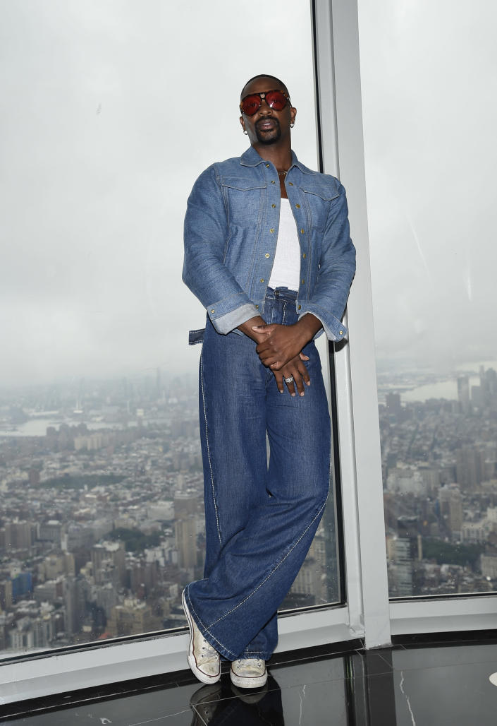 Fashion designer LaQuan Smith participates in a New York Fashion Week kickoff event at the Empire State Building on Thursday, Sept. 9, 2021, in New York. (Photo by Evan Agostini/Invision/AP)