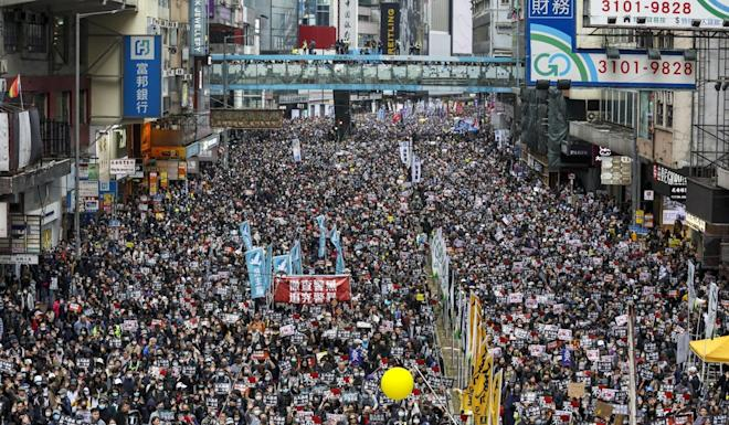 Protesters take over the streets in Hong Kong on New Year's Day as the long-running unrest makes its mark on the 2020 presidential election in Taiwan. Photo: Nora Tam