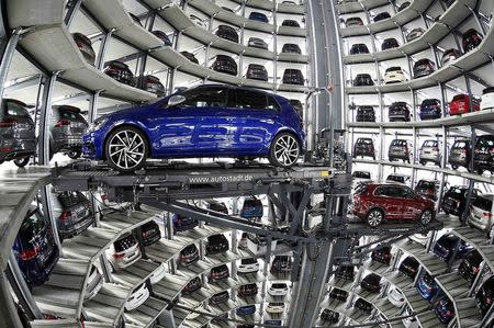 VW cars are loaded in a delivery tower at the plant of German carmaker Volkswagen in Wolfsburg