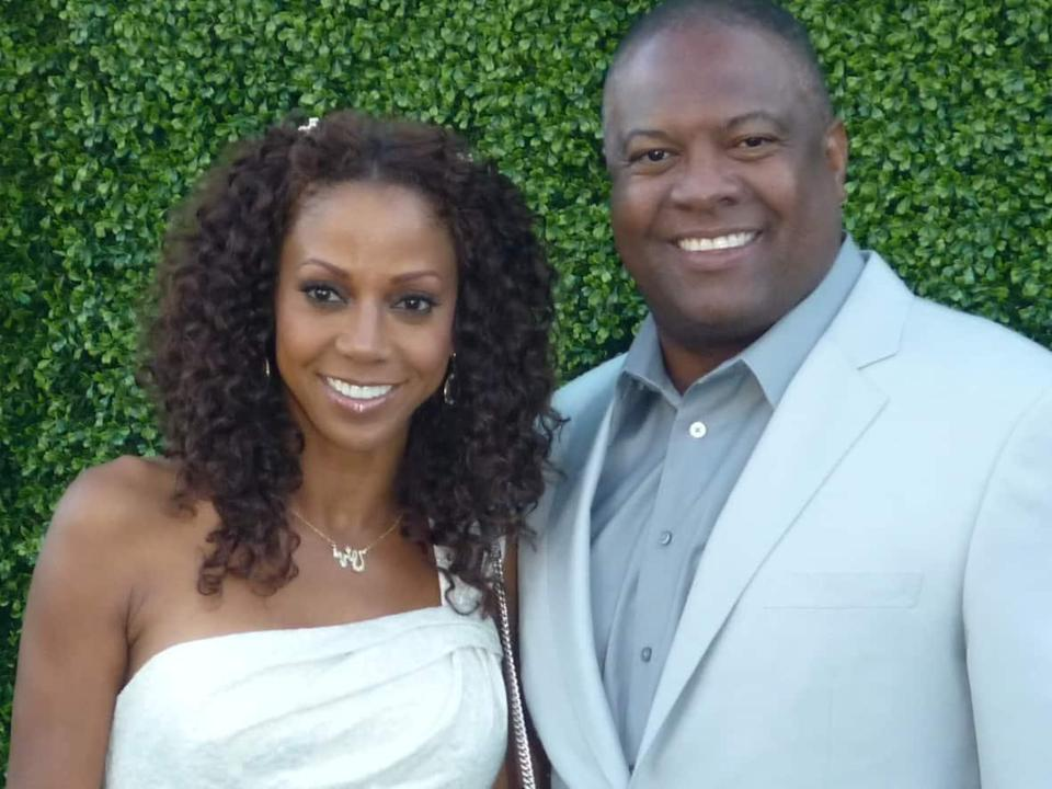 Actor Holly Robinson Peete and her husband, former NFL quarterback Rodney Peete, pictured in 2010. Two of their sons were barred from boarding a flight at Vancouver International Airport on Monday. (Greg Hernandez/Creative Commons - image credit)