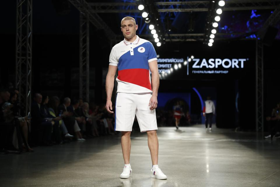 A model displays the Olympic uniforms for Russian athletes in Moscow, Russia, Wednesday, April 14, 2021. Russia presents its Olympic kit for the Tokyo Games, which shouldn't depict any symbols of the country. Russian athletes will compete at the Tokyo Olympics as neutral after the Court of Arbitration for Sport last December banned Russia from using its name, flag and anthem at any world championships for the next two years because of state-backed doping. (AP Photo/Pavel Golovkin)