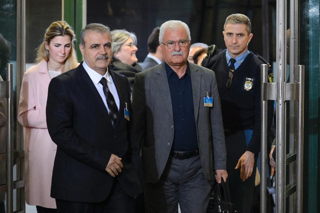 Members of Syria's main opposition group Asaad Zoabi (C-L) and George Sabra (C-R) arrive to attend Syrian peace talks at the United Nations offices in Geneva on February 1, 2016