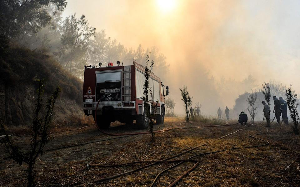 Firemen battle to extinguish fire during the second day of the wildfire on the island of Rhodes - LEFTERIS DAMIANIDIS/EPA-EFE/Shutterstock