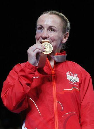 Boxing - Gold Coast 2018 Commonwealth Games - Women's 51kg - Victory Ceremony - Oxenford Studios - Gold Coast, Australia - April 14, 2018. Lisa Whiteside of England poses with her gold medal. REUTERS/Athit Perawongmetha