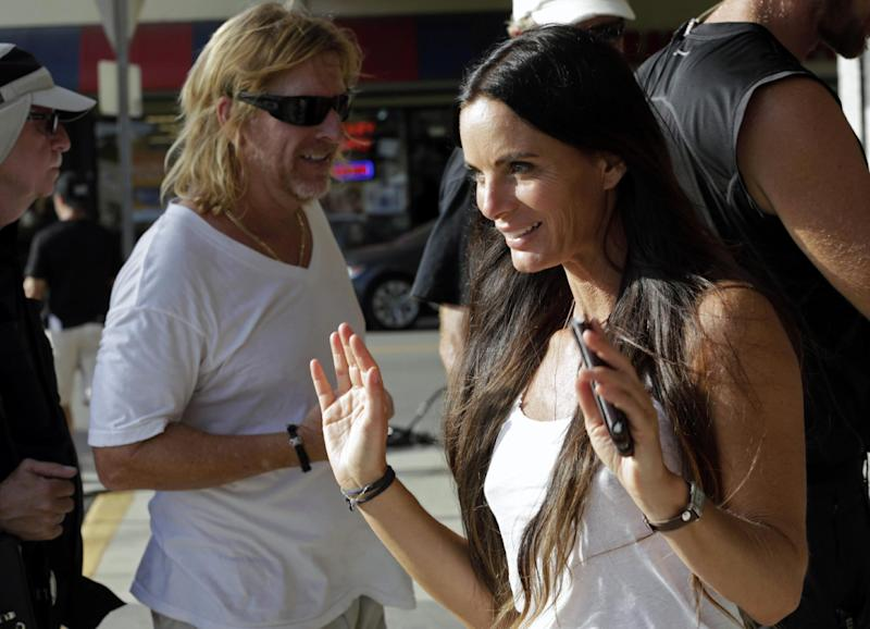 "In this July 24, 2013, photo, actress Gabrielle Anwar takes a break during taping for an episode of ""Burn Notice"" in Miami. The cable spy drama is coming to an end after seven seasons with a big finale next Thursday, Sept. 12, 2013. (AP Photo/Alan Diaz)"