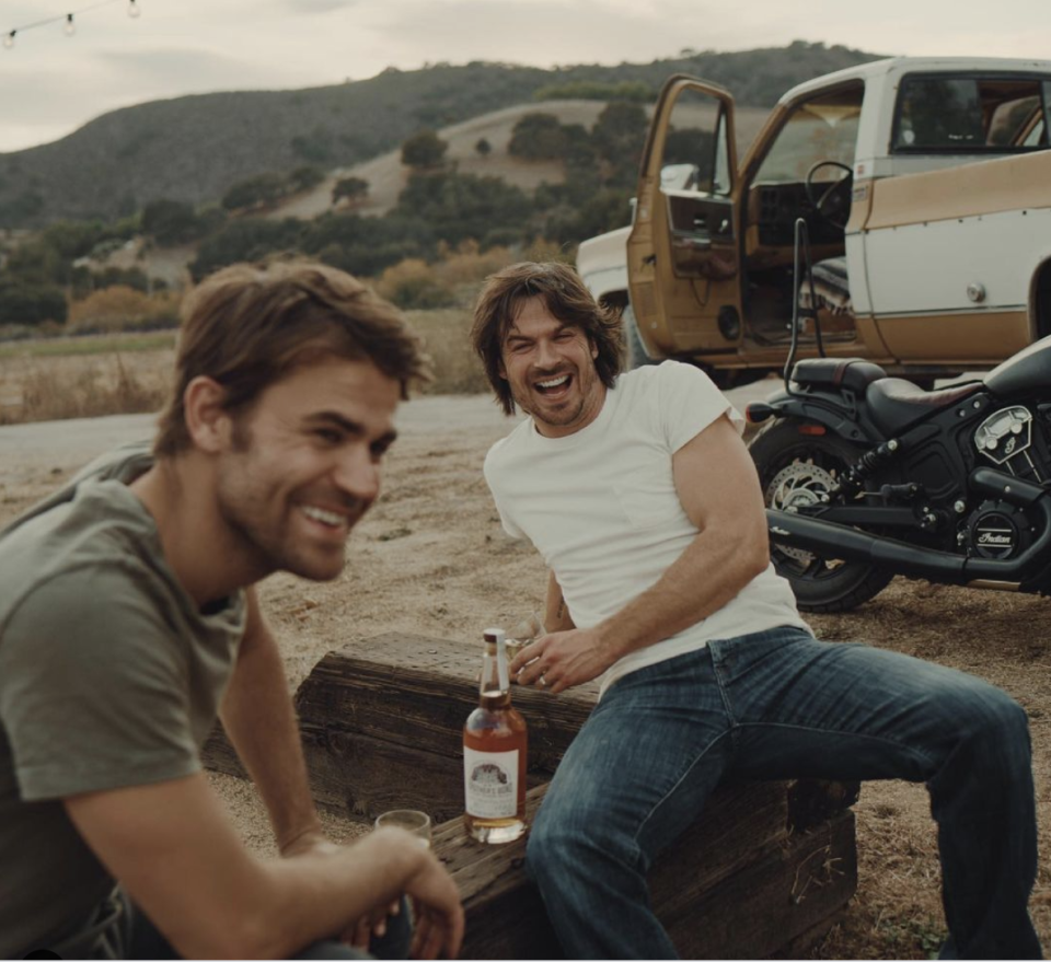 Paul Wesley (left) and Ian Somerhalder say they drew inspiration for their Brother Bourbon brand from the brotherly bond they formed playing the Salvatore brothers on the CW hit