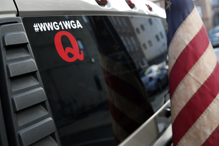 An American flag is affixed to the back of a Hummer vehicle parked near the Pennsylvania Convention Center where votes are being counted, Friday, Nov. 6, 2020, in Philadelphia. Police said Friday they arrested two men Thursday for not having permits to carry firearms near the center. Police said the men acknowledged that the Hummer spotted by officers near the center was was their vehicle. (AP Photo/Rebecca Blackwell)