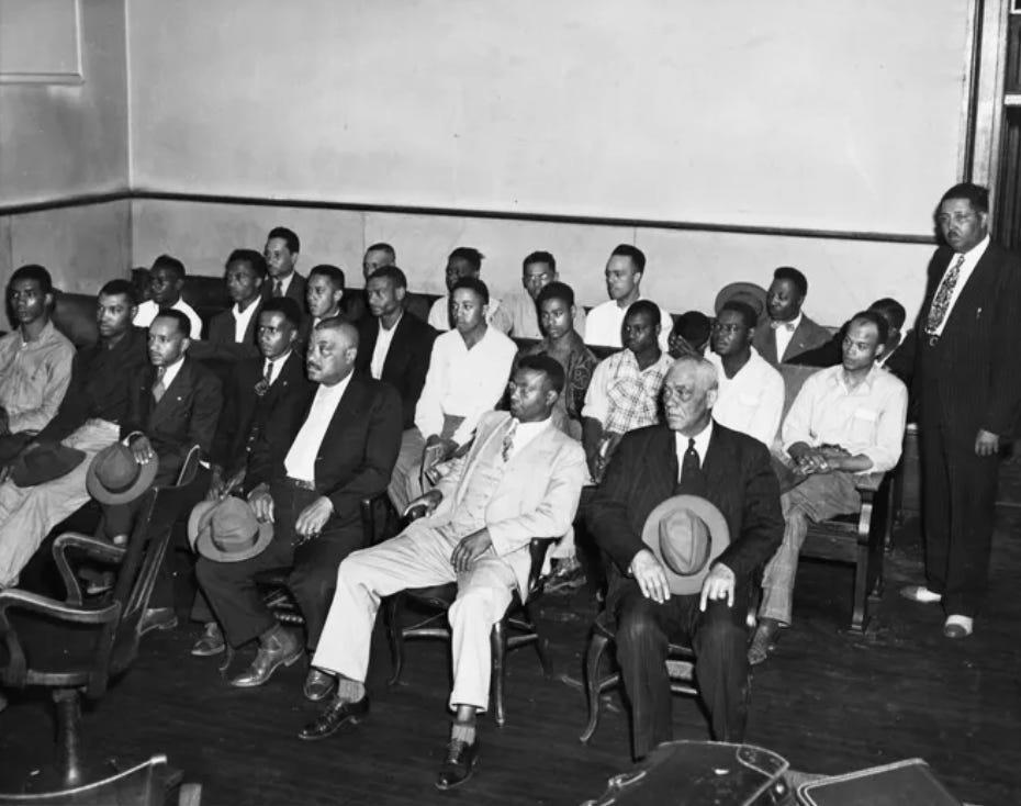 Twenty-five Black men sit in Maury County Court on May 28, 1946, for a hearing in their case.