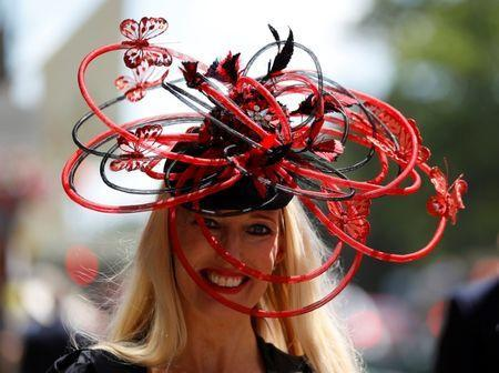 Horse Racing - Royal Ascot - Ascot Racecourse, Ascot, Britain - June 21, 2018 A racegoer poses before the start of the racing REUTERS/Peter Nicholls