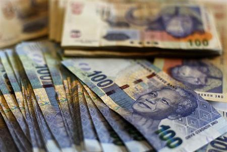 New South African bank notes featuring an image of former South African President Nelson Mandela are displayed at an office in Johannesburg