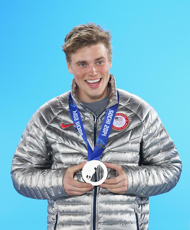 SOCHI, RUSSIA - FEBRUARY 13: Silver medalist Gus Kenworthy of the United States celebrates during the medal ceremony for the Freestyle Skiing Men's Ski Slopestyle on day six of the Sochi 2014 Winter Olympics at Medals Plaza on February 13, 2014 in Sochi, Russia. (Photo by Quinn Rooney/Getty Images)