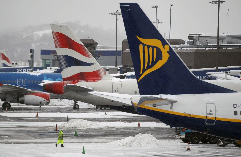 Workers clean snow from a runway at Edinburgh Airport in Edinburgh, Scotland. Edinburgh Airport has been named among the top child-friendly airports in the world by Conde Nast Traveller India magazine.