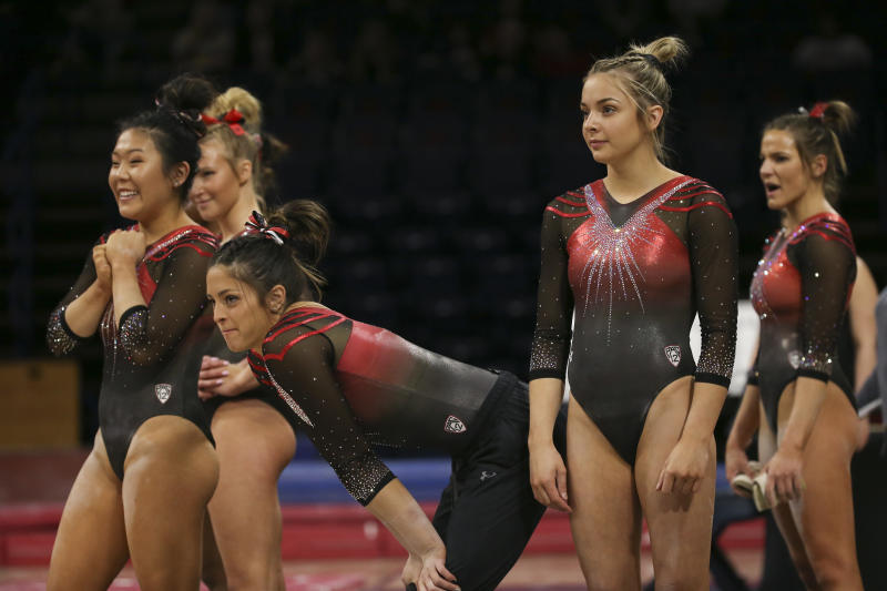 TUCSON, AZ - FEBRUARY 01: Members of Utah watch as a teammate preform on floor during a college gymnastics meet between the Utah Utes and the Arizona Wildcats on February 01, 2020, at McKale Center in Tucson, AZ. (Photo by Jacob Snow/Icon Sportswire via Getty Images)