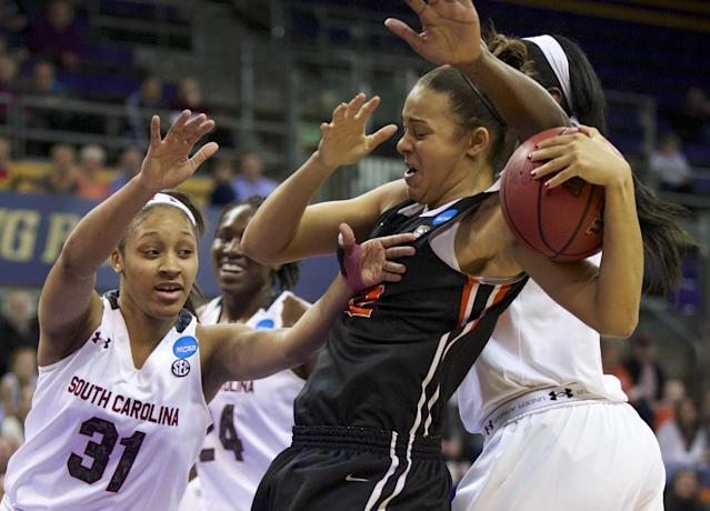 Oregon State forward Deven Hunter (32) is fouled as South Carolina's Asia Dozier (31) goes for the ball during the first half of a second-round game of the NCAA women's college basketball tournament, Tuesday, March 25, 2014, in Seattle. (AP Photo/The Oregonian, Randy L Rasmussen)