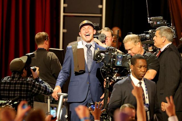 Johnny Manziel is seen leaving the stage after being selected by the Cleveland Browns at the 2014 NFL Draft at Radio City on Thursday, May 8th, 2014 in New York, NY. (AP Photo/Gregory Payan)