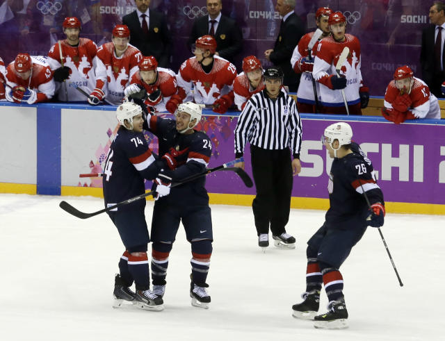 USA forward T.J. Oshie is congratulated by USA forward Ryan Callahan and forward Paul Stastny after Oshie scored the winning goal in a shootout against Russia during overtime of a men's ice hockey game at the 2014 Winter Olympics, Saturday, Feb. 15, 2014, in Sochi, Russia. (AP Photo/Morry Gash)