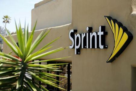 The logo of U.S. mobile network operator Sprint Corp is seen at a Sprint store in San Marcos, California